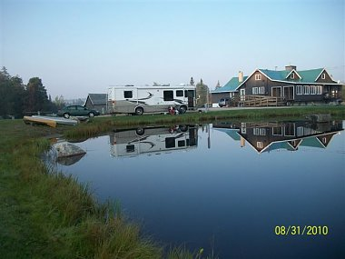Click image for larger version  Name:Our reflection in pond.JPG Views:301 Size:41.7 KB ID:17052