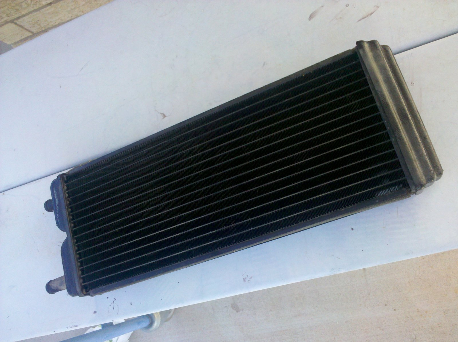 Click image for larger version  Name:Acme heater core with plastic end on.jpg Views:1059 Size:241.8 KB ID:33657