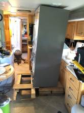42-raising-the-new-refrigerator-so-it-can-be-rolled-on-the-dolly.jpg
