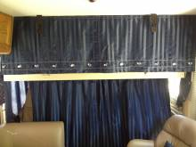 S005_Drivers_Area_with_the_Bunk_Down_and_Curtain_Closed.JPG